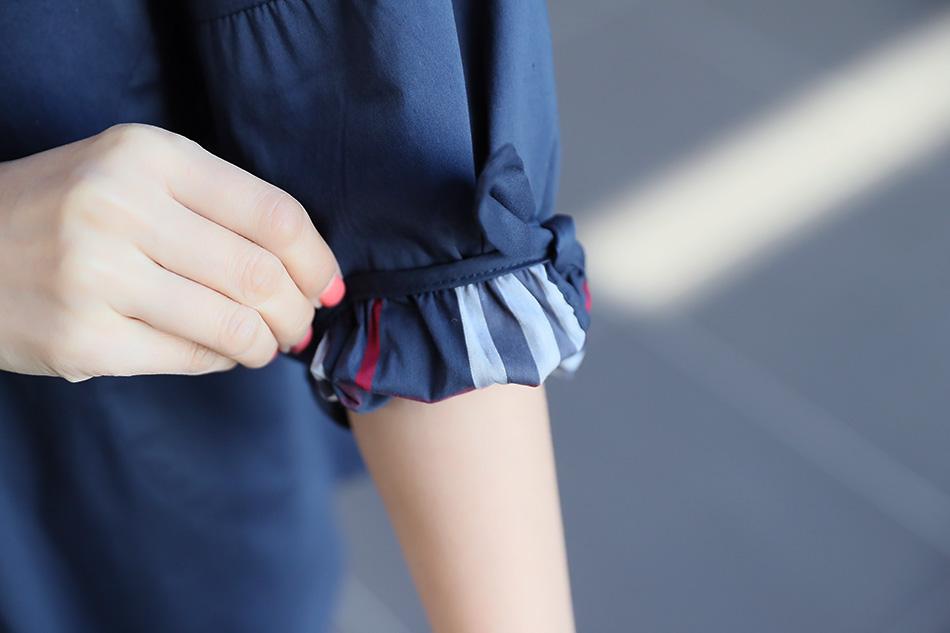 카라, 소매단, 뒷면주름에<br>체크배색으로 세련미 넘치는 디자인