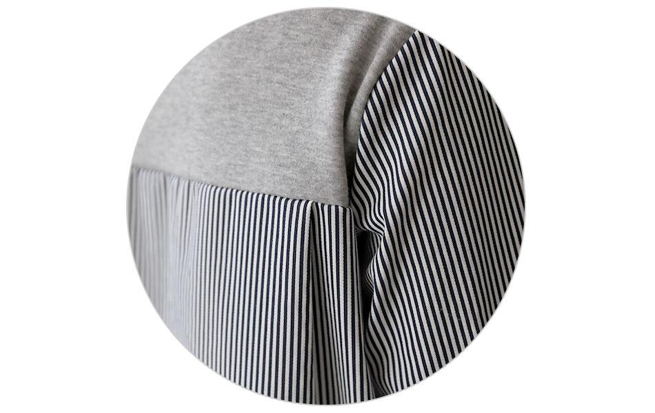 뒷면과 소매는 스트라이프 패턴의 셔츠로